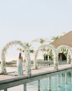 """The eight (!) arches lining the boardwalk aisle at this Maldives wedding were made of baby's breath, silk wisteria, and orchids. According to the bride, the structures were her """"favorite décor element by far. Maldives Wedding, Maldives Beach, Visit Maldives, Dock Wedding, Wedding Ceremony, Wedding Weekend, Wedding Day, Wedding Bells, Malay Wedding"""