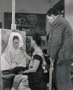 Frida Kahlo painting while Diego Rivera notes, 1940. Bernard Silberstein.