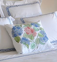 The Artisan Hydrangea Pillow by Loretta Caponi. A beautifully embroidered accent pillow made of 100% Luxurious Italian Linen. With exquisite details of blue and green, this pillow is truly unique. Exclusively made for Pioneer Linens by Italian designer, Loretta Caponi.
