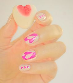 Play with neon + nude colors to give yourself a stand out manicure for Valentine's Day.