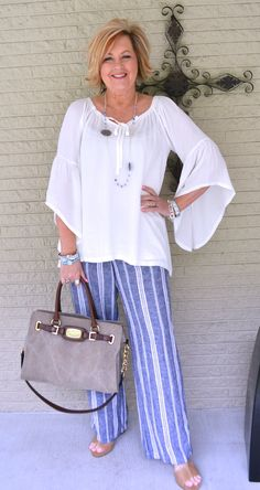 I like the different take on the palazzo pant. Cute blue and white combo.