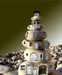 .Awe inspiring - don't think I could make it tho - smooth rocks cut to look like homes, stacked.