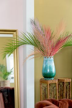 Pink wall, chartreuse wall, velvet, rattan and painted palm fronds.  Perfection.