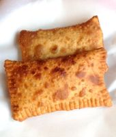 Hearts of Palm Fried Pastries - Pastel de Palmito. A Brazilian street snack stuffed with cheese and veggies.