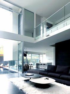 einrichtungsideen wohnzimmer weißer teppich schwarzes sofa