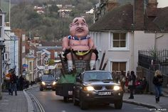Bonfire Night: Fireworks and effigies burnt as Guy Fawkes celebrated, in pictures. An effigy of defeated Scottish independence leader Alex Salmond is paraded through Lewes, East Sussex before it gets burnt in the traditional bonfire celebrations. Lewes Bonfire Night, Alex Salmond, Dying Of The Light, Scottish Independence, King Richard, Guy Fawkes, Effigy, Pictures Of The Week, Burns