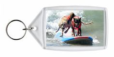 Keyring featuring Dogs, big and small, and some in tandem or with their owner…