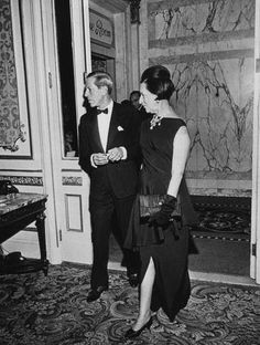 Diana Vreeland escorted by her husband Reed.
