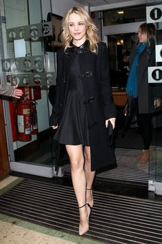 Rachel McAdams in coat by The Row, dress by Lover & Brian Atwood ruffle heel pumps.