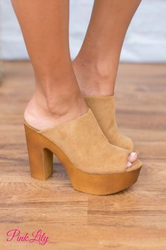 You're going to love rocking these new heels! Natural faux suede material with a wood colored platform heel. An open toe, open back, and a 5 inch heel finishes your new favorite heels!