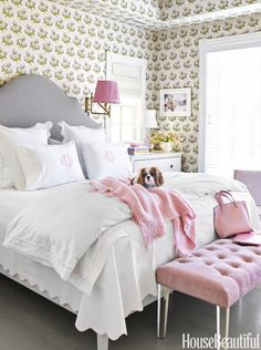 Grownups can have pink bedrooms too. Colefax and Fowler's Bowood wallpaper covers the walls and ceiling of a townhouse bedroom. A pink shade tops Thomas O'Brien's Paolo sconce, matching the monogrammed linens and tufted bench.