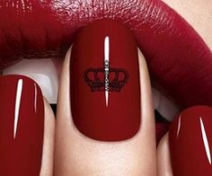 dark red nails and lips. crown design