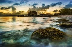 Every now and then you see some rocks along the coast that are not smooth, but covered with moss and clinging vegetation. It's kind of strange how nearby rocks are worn smooth and slick, while others, like this one below, look like they could be in some deep jungle freshwater river. - Virgin Gorda, Caribbean - Photo from #treyratcliff Trey Ratcliff at http://www.StuckInCustoms.com