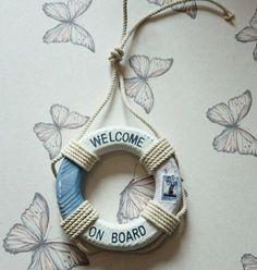Seaside wooden life ring sing