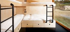 In this boutique shipping container hotel, there's a room with custom plywood bunk beds for four people.