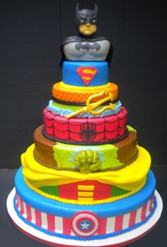 Superhero cake, I love how each tier identifies a superhero without being explicit!  Very beautiful and very clever. Ryan would flip over this birthday cake!