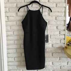 NWT F21 Halter Dress NWT F21 black dress. Halter neck and open back. Perfect LBD ❤️ Forever 21 Dresses Mini