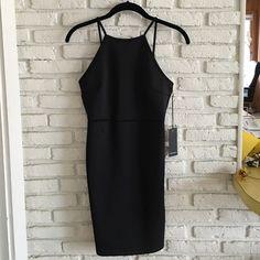 NWT F21 Halter Dress NWT F21 black dress. Halter neck and open back. Perfect LBD ❤️ Forever 21 Dresses Mini