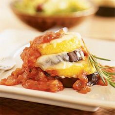 Eggplant Parmesan Stacks Recipe Main Dishes with eggplant, polenta, olive oil cooking spray, onions, garlic, fresh basil leaves, tomatoes, pepper, salt, part-skim mozzarella cheese, grated parmesan cheese, rosemary sprigs, breadstick