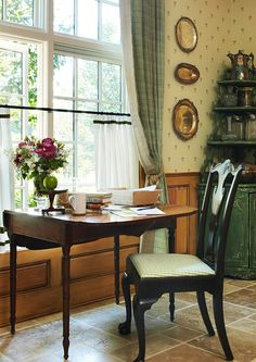 An antique Pembroke table at a kitchen window is a lovely spot for a morning cup of coffee and for organizing the day.