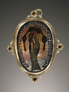 "Roman, Cameo with hand pinching an ear and a knotted scarf or diadem, 400-500 (source). The Greek inscription reads: ""Remember me, your dear sweetheart, and fare well, Sophronios."" The gold setting is modern."