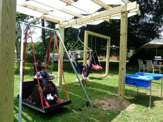 Wheelchair swing, Full body swing, and wheelchair water table (in a back yard). I'd like to build something like this in my backyard. My son would love it!