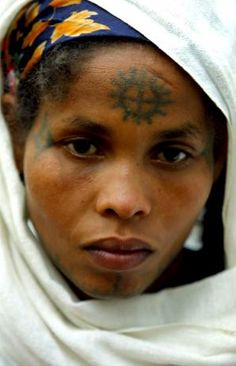 Africa | Jewish Ethiopian women with a cross tattooed on her forehead.  Beta Israel School, Addis Ababa, Ethiopia | ©Natalie Behring-Chisholm.