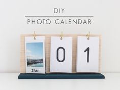 If you love taking pics of your food or of yourself doing yoga then create a photo calendar with some C-hooks, some wood, and 12 great shots.