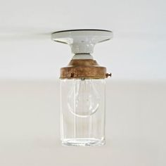 The Crystal Jelly Jar Light, by Deborah Ehrlich, via Remodelista. Made in Sweden. Handmade Swedish crystal shade with brass shade holder and porcelain fixture shade.