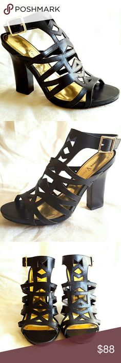 Vince Camuto Black Leather Ankle Stap Sandals Laser cut all leather caged sandals by Vince Camuto.  These are modern sexy chic with their tapered stacked heel, geometric patterns, gold buckle hardware, and shiny gold lining - perfect for cocktail dresses and casual jeans.  100% Genuine Leather upper, insole, & double layer sole.  Excellent condition, original box included. Like new.  Clean. Vince Camuto Shoes Heels