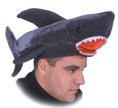 Which is more amazing: The shark hat, or the look of determination in this man's eyes?