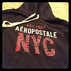 Aeropostale Hoodie Black Aeropostale hoodie, pink and black zebra print lettering, barely worn, good condition, size large, but fits more like a small Aeropostale Jackets & Coats
