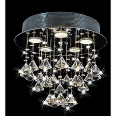 With its ultra-modern design, this round ceiling chandelier makes a bold design statement. Crafted with a sleek chrome fixture, the chandelier features a cascade of drop crystals and five lights that provide just the right amount of illumination.