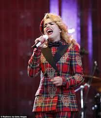 Mad about plaid: Paloma Faith hits the right note in head-to-toe tartan ensemble as she performs at Rock In Rio festival