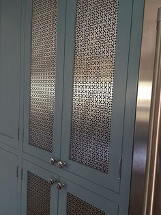 Attention to detail in using a custom mesh as a center panel provides a clean look fulfilling the designer's vision.