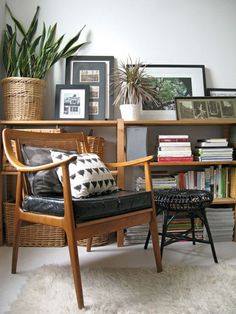love it all! so my style! pillows + leaning art + stacked books + vintage / thrift mix