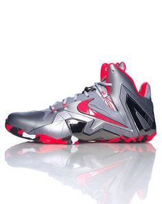 d1ba685c3f98 NIKE Lebron James Men s mid top sneaker Lace lock closure All-over silver  color Metallic and crimson accents Cushioned inner sole for comfort