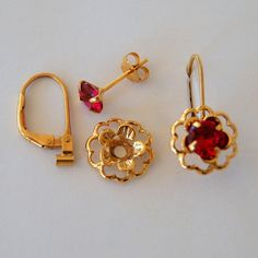 New lower prices. Ruby Red Earring Jacket Set Includes Red Cubic Zirconia Posts, Gold Flower Style Earring Jacket and Earring Convertible Gold Earrings Designs, Gold Jewellery Design, Gold Jewelry, Cz Jewellery, Beading Jewelry, Ruby Jewelry, Gold Necklaces, Ear Jewelry, Antique Jewelry