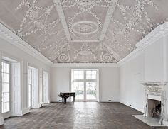 Minimal neo-classical space wiith vaulted ceiling and herringbone floors