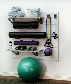 Home Fitness Kit The storeWALL Home Fitness Equipment Storage Kit helps you create your own home gym oasis. Hold yoga mats, free weights, towels, and resistance bands. Home Gym Garage, Diy Home Gym, Gym Room At Home, Home Gym Decor, Home Office, Small Home Gyms, Small Homes, Workout Room Home, Home Exercise Rooms