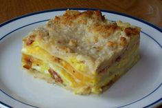 Bacon  n  Egg Lasagna from Food.com:   								Everyone i have served this to has requested the recipe. It's easy to feed to a crowd at holiday time because it can be made ahead. I found it in April/May 2000 issue of Taste of Home.