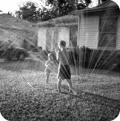 Cooling off in the sprinkler...