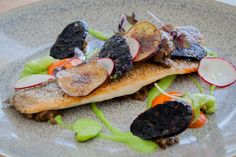 Pan Seared Branzino, Fire Roasted Eggplant Caviar, Fava Beans, Peperonata