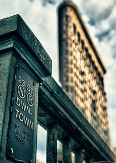 Flatiron background, 23rd Street, N, R subway station in foreground by Stott Photo on flickr