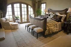 Open bedroom with a panoramic view through glass-paned French doors. love this gorgeous bed