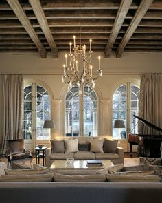 Love the scale of this room! The windows and the exposed beams are my favorites.
