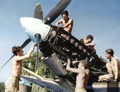 RAF ground crew work on a Spitfire Mk VIII's Merlin engine at Darwin, Australia, c.1943.No. 54 (Spitfire) Squadron RAF, Darwin airfield in Northern Australia. Photographer: Argus newspaper, Melbourne Image courtesy of the State Library of Victoria