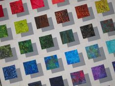 COLOR BLOCK  48 inches square Quilt Original by carolinasquirrell, $170.00 - I like how the grey squares give it a 3D look, like the colors are floating above
