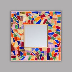 "Small Mosaic  65.00 Classic mosaic mirror.  A smaller square framed mirror with a whirl of colors.  Handmade in the USA Materials: mirror, glass, stained glass Made to order Size: 12"" x 12"" ADD TO CART"