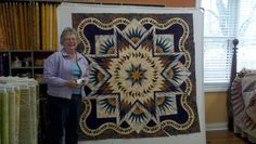 Quiltworx.com Certified Instructor Catherine Erickson taught a Technique of the Month Class at Olive Juice Quilts in Onalaska WI.  Here are photos of the beautiful fun projects her students completed!